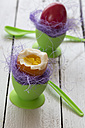 Boiled easter eggs in green eggcups, egg spoons - SARF000262