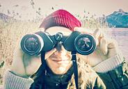 Austria, Mondsee, man looking through binoculars - WV000452