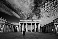 Germany, Berlin, view to Brandenburger Tor with tourist in front - PA000442