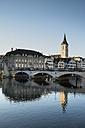 Switzerland, Zurich, view to bridge, St. Peter's church, houses and Limmat River - ELF000894
