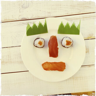 Sushi arranged on a plate as a face, Freiburg, Germany - DRF000528