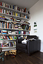 Book shelf and toys in a room with armchair - TK000301
