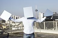 Germany, North Rhine-Westphalia , Cologne, man hidden behind light blue rectangles - FMK000968