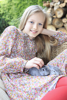 Portrait of smiling girl with two rabbits on her lap - VTF000119