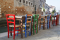 Italy, Venice, Cannaregio, street restaurant at Rio de la Misericordia, empty chairs - LAF000640