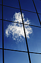 Clouds reflecting in glass front of an office building - HOHF000523