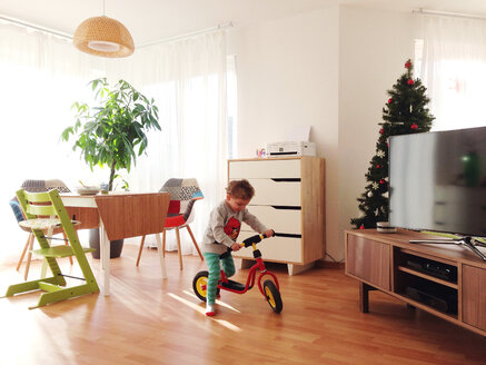 Toddler with scooter in living room - AFF000029