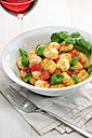 Bowl of gnocchi with tomato sauce, mozzarella balls and basil - IPF000068