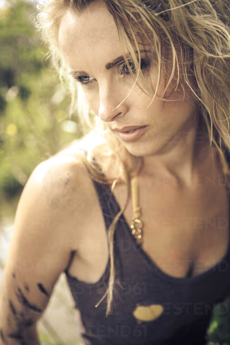 Blond woman in tank top outdoors - VTF000123 - Val Thoermer/Westend61