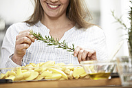 Woman preparing potato gratin - FMKF000993