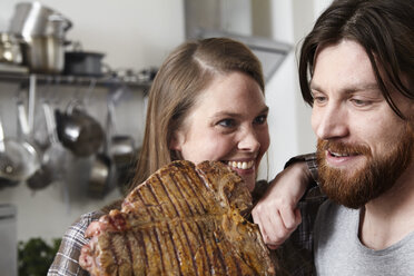 Couple with large steak in kkitchen - FMKF001055