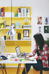 Female fashion blogger working at her office - EBSF000065
