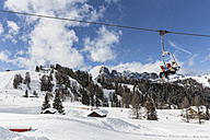 Italy, Dolomites, Alto Adige, Sassongher, winter sport region Alta Badia, ski lift and people - MAB000214