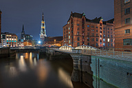 Germany, Hamburg, old warehouse district (Speicherstadt) with St Catherine's church at background by night - RJF000005