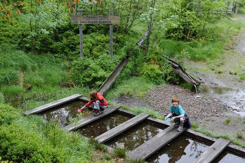 Germany, Bavaria, Bavarian Forest National Park, Sankt Oswald-Riedlhuette, children playing at Gold panning place - LB000611