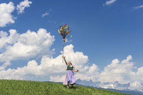 Austria, Salzburg State, Altenmarkt-Zauchensee, girl throwing Palmbusch up in the air - HHF004778
