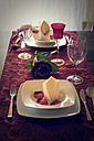 Two place settings on festive laid table - SARF000297