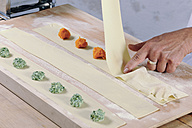 Producing homemade tortelloni with apinach ricotta and pumpkin filling - IPF000088