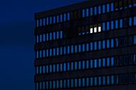 Germany, Dusseldorf, Lighted windows in office building - KJF000296