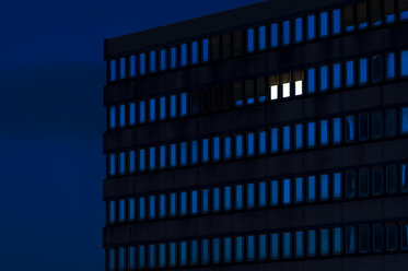 Germany, Dusseldorf, Lighted windows in office building - KJF000296