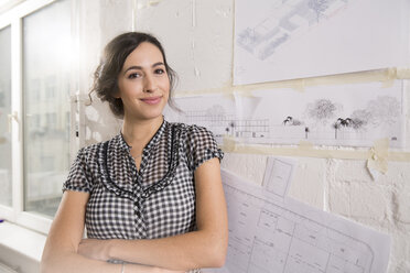 Portrait of young female architect in office - FKF000439