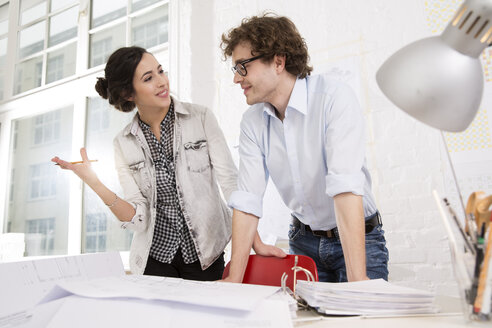 Two young architects working together in office - FKF000458