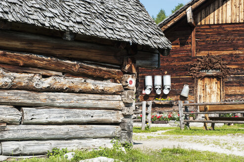Austria, Salzburg State, Untertauern, Pongau, alpine cabin with milk churns and stable - HHF004756