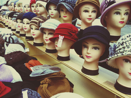 Austria, Krems, hats on mannequins heads for sale on the market - DIS000628