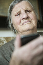 Portrait of senior woman holding smartphone - JATF000709