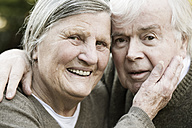 Portrait of smiling senior couple head to head - JATF000716