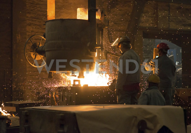Germany, two men at work in foundry - SCH000099 - Sten Schunke/Westend61