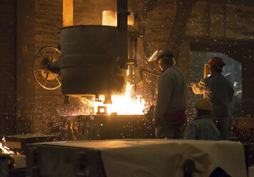 Germany, two men at work in foundry - SCH000099