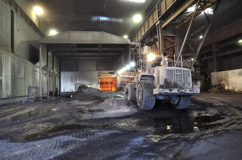 Germany, Steel mill, removal of slag with shovel excavator - SCH000086