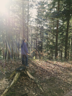Woman in forest, Backlit, relaxation, Weyarn, Bavaria, Germany - GSF000785