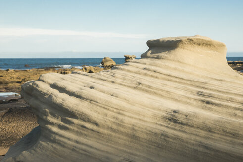 Australia, Seal Rocks, view to outwashed rocks at beach - FBF000283