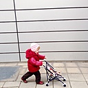 Little girl with doll carriage, Munich, Bavaria, Germany - GSF000788