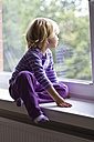 Little girl looking out of window - JFEF000286