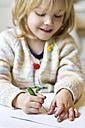 Little girl prickling, close-up - JFEF000313