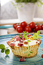Egg muffin with ham cubes on plate - CSTF000147