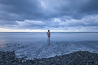 New Zealand, Hokitika Beach, Rear view of nude man - WV000469