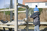 Germany, Mecklenburg-Western Pomerania, Ruegen, little boy at playground - MJF000936