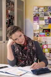 Portrait of female pupil at her desk - BTF000323