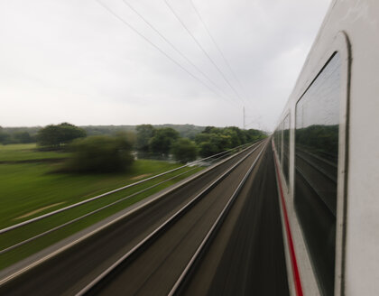 Germany, fast moving train in landscape - HC000017