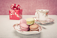 Cup of coffee, bowl of macarons and a gift - VTF000157