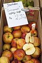 Wooden box of apples on market - WIF000482
