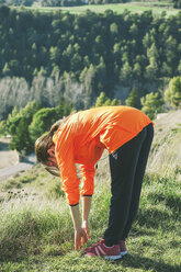 Young female jogger stretching - EBSF000090