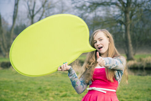 Germany, Landshut, Female teenager with green speech bubble - SARF000384
