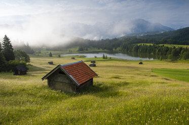 Germany, Bavaria, Werdenfelser Land, lake Geroldsee with hay barn at sunset, in background the Karwendel mountains - RJF000024