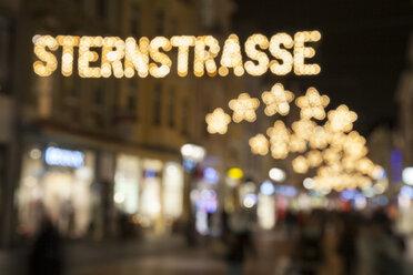 Germany, North Rhine-Westphalia, Bonn, Festive decorated shopping street - WIF000497