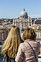 Italy, Rome, Two women looking at St. Peter's Basilica from Castel Sant'Angelo - EJW000383